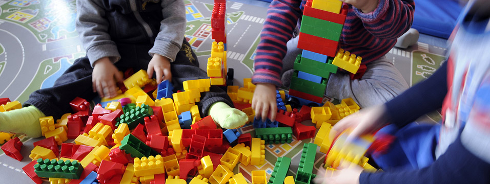 http://www.dreamstime.com/stock-image-children-playing-three-little-colored-plastic-toys-image31168661